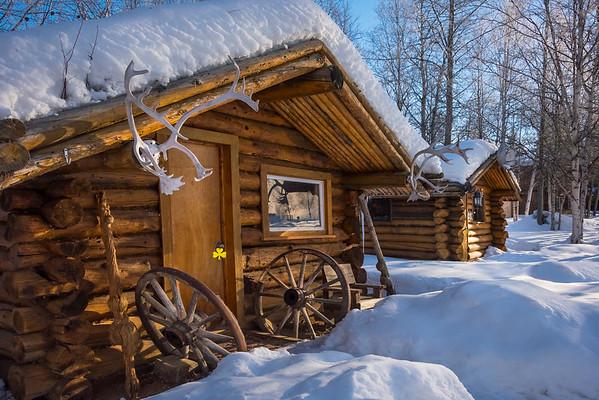 A Row Of Snowy Alaksan Cabins -Chena Hot Springs Resort, Fairbanks, Alaska