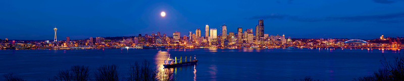 """November Moon"" A rare clear night on a full-moonrise as viewed from West Seattle looking east to the Cascades, including everything from the Space Needle to the stadiums."