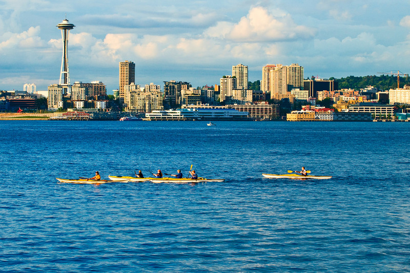 People kayak in Elliot bay in front of the Seattle, WA waterfront from West Seattle