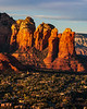 "View of Sedona from Airport Road overlook as sunset is approaching. ""Coffee Pot"" on right end of formation."