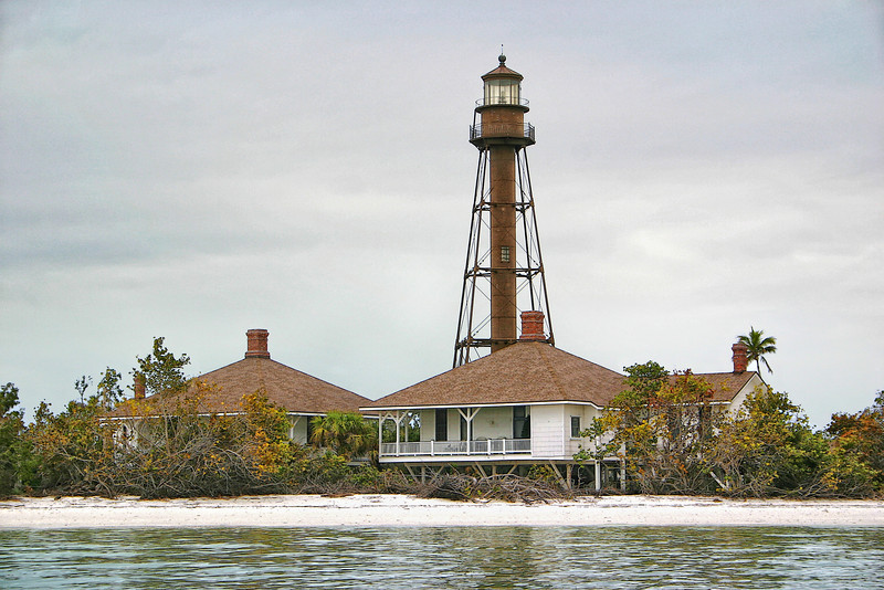 Sanibel Light post Hurricane Charlie with seagrapes tossed about the premises