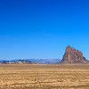Shiprock rises nearly 1,700 feet above the valley floor.  One World Trade Center is 1,776 feet tall.