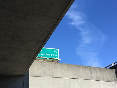 Concrete freeway sign and sky, June 2019