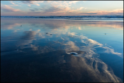 Reflections down the beach.