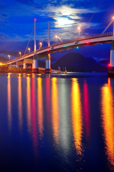 The moon shone brightly across the bridge.