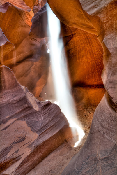 Lightfall II<br /> <br /> A beam of light cascades to the floor of Antelope Canyon. <br /> Navajo Nation, Page, Arizona, USA