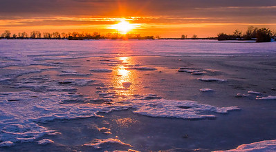 ~~ Frozen Sunset ~~  Had the best time clicking this shot trying to balance myself on the frozen icy surface of Bountiful pond.