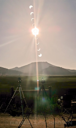 Solar eclipse, 5-20-12. Shot from Sierra Valley, Plumas Co, CA. This is a vertical stitch layered with a shot of the scene from behind my tripods, produced in photoshop to show the progress of the eclipse from 5:51pm till 708pm. The top image was captured first.