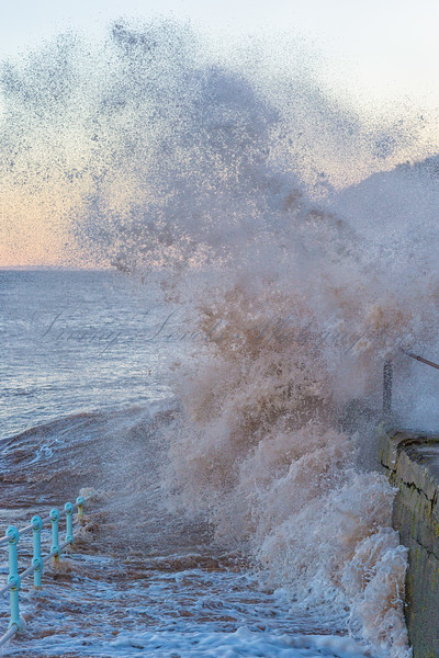 Wave breaking against the sea wall at the East end of Blue Anchor Bay at high tide on the morning of 1st Feb 2014
