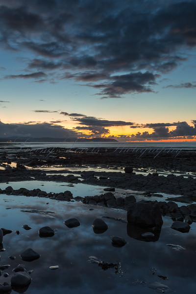 The sun sets at the end of an Autumn day over the Bristol Channel at Kilve