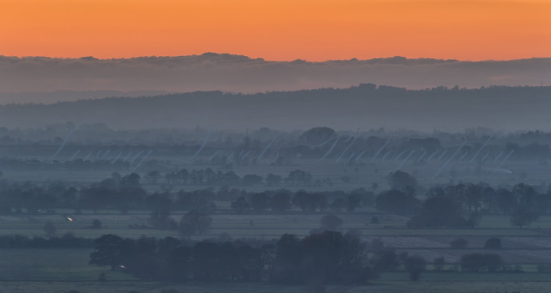 Sunset over the Somerset Levels, taken Walton Hill looking over to Exmoor