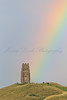 Rainbow after heavy rain behind St Michael's Tower on Glastonbury Tor