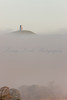 Glastonbury Tor surrounded by late Autumn mist, crating the impression of an island