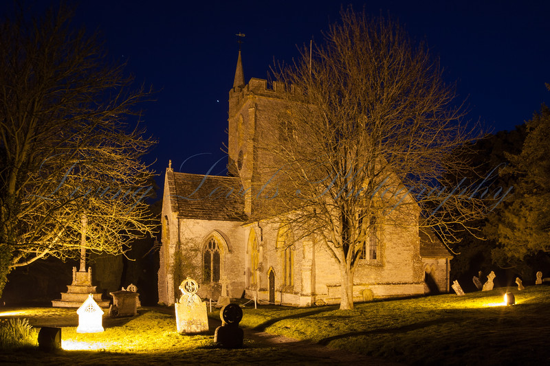 Night falls and Charlton Mackrell church and graveyard are illuminated by flood lights.