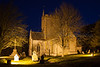 Night falls and Charlton Mackrell church and graveyard are illuminated by flood lights