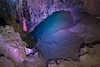 Chamber 9 in Wookey Hole Caves is lit with coloured lights.  This chamber is used  as a base for dives exploring further.