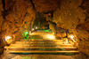 The steps into the main cave chamber are lit with coloured lights at Wookey Hole