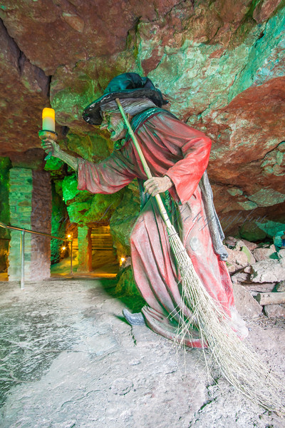 "The ""witch"" of Wookey Hole keeping the entrance clean"