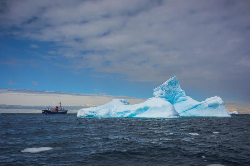 Ships Surrounding The Arch Iceberg