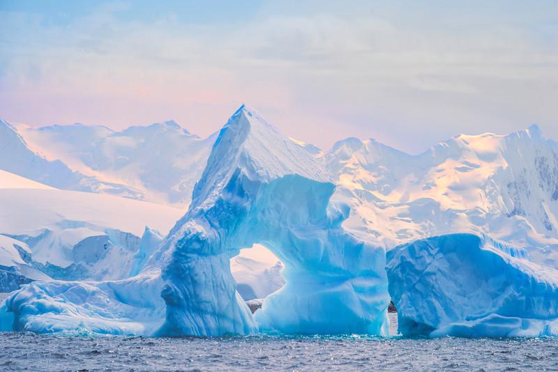 Iceberg Arch In Twilight Warmth -  Cuverville Island, Antarctica