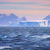 Mist Surrounds Iceberg and Land