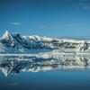 Still Reflections Of Snow Capped Island Near Neko