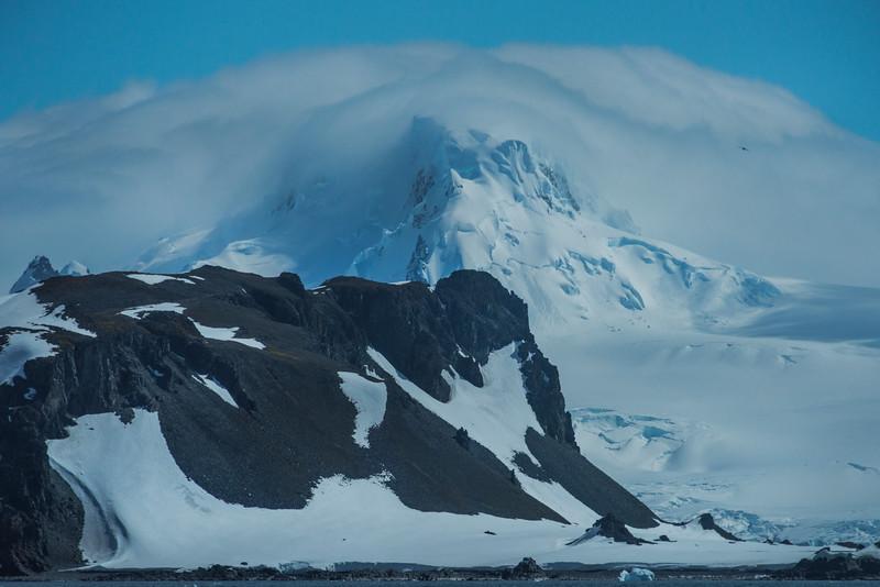 Mountain Peak Capsulated In Mist