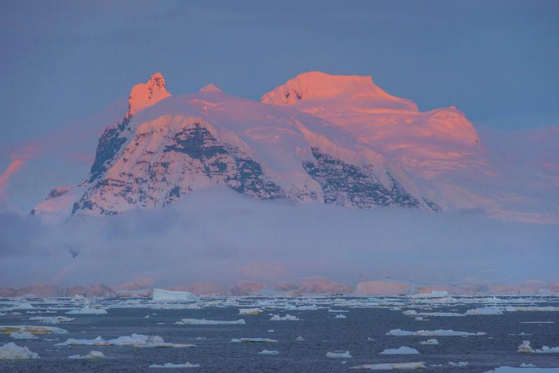 Very Tops Of Peaks In Alpenglow