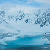 Foreground Icebergs And Snow Peaks