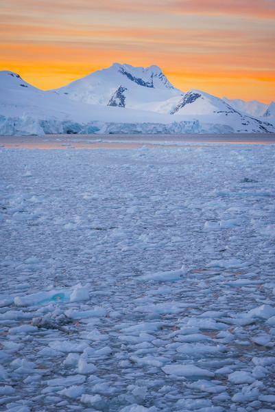 Brillance Of An Orange Sunset In The Antarctica