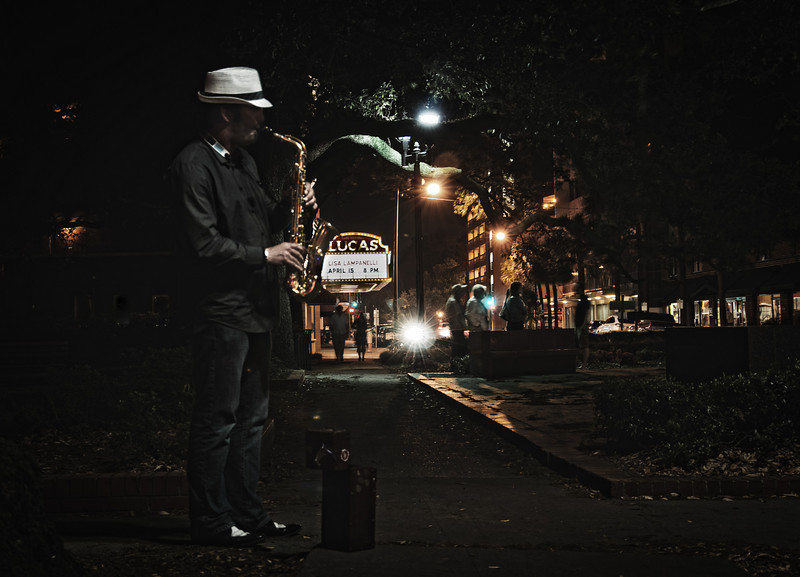 A talented street musician playing for the lucky ones to walk through one of the many squares in Savannah, Georgia.