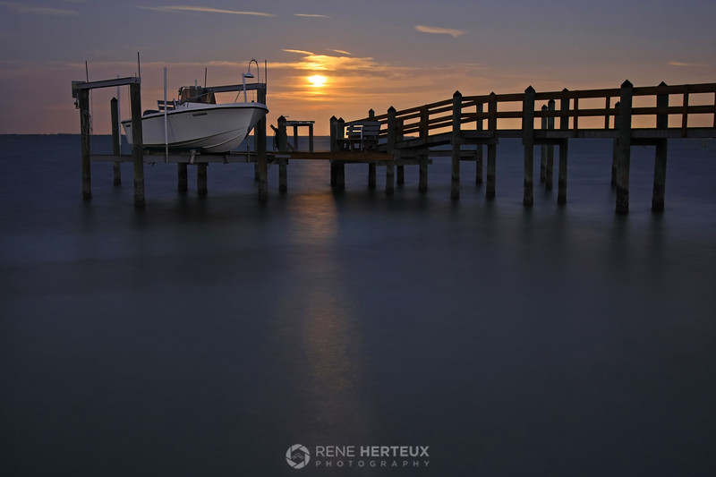 Dock with full moon rise
