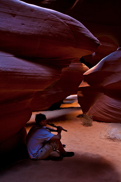 Navajo guide Lynnwood playing his flute in upper antelope canyon
