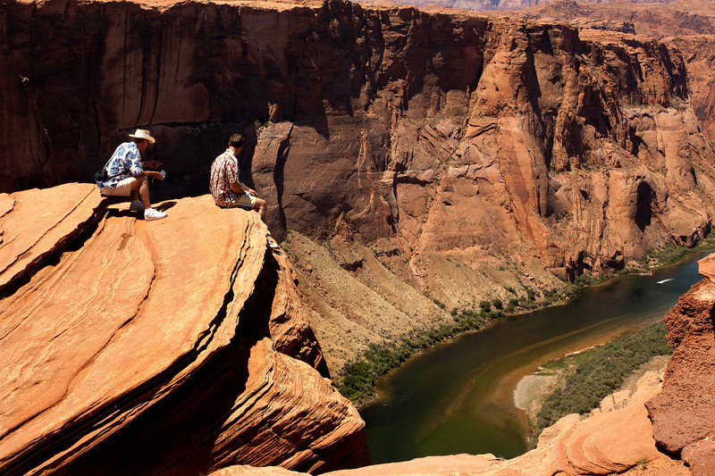 Horseshoe Bend.  second trip.  These guys have a lot more guts than I did.  I approached on my belly.