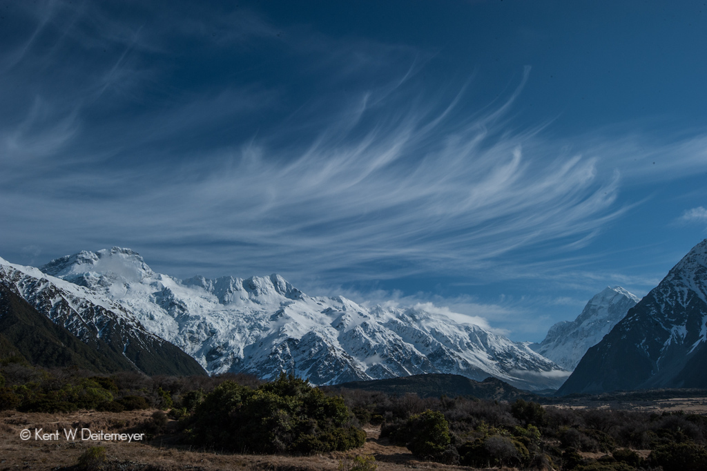 Mare's tail cloud formation (Cirrus Incincus) over Mt Sefton (left) and Mt Cook (right). Mt Cook National Park.