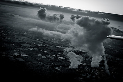 Steam rises over the horizon from a refinery in the South Bay