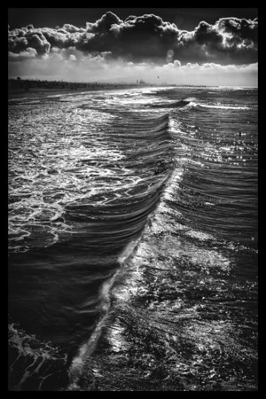 Dark Clouds and Waves Seen from the Manhattan Beach Pier, Manhattan Beach, California.