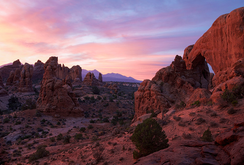 Sunrise behind North Window looking at South Window, Arches NP