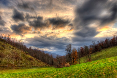 Dramatic sunset on Walnut Grove Farm in Nebo with a fantastic view down the valley where my wife grew up. I combined nine different photos for this effect as the clouds were moving fast, hence the fluid effect.