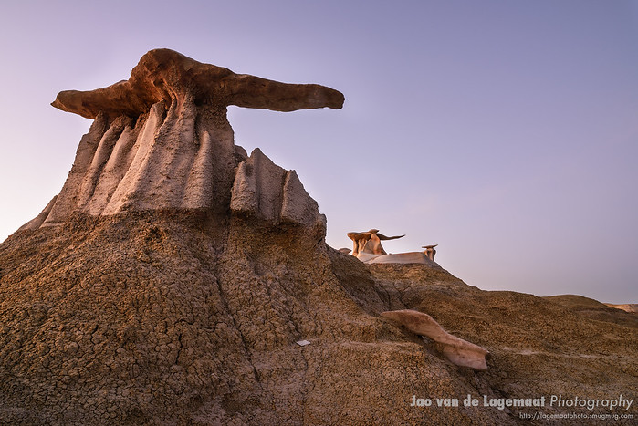 The Wings in the Bisti badlands are glowing in warm twilight light