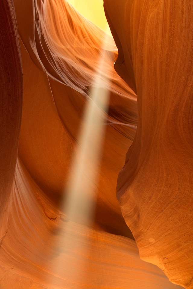 Upper Antelope Canyon, near Page, AZ.  The Sunbeams appear from April to September and only around noon each day.  Definitely take the 2 1/2 hour tour if you want to catch the best photos.