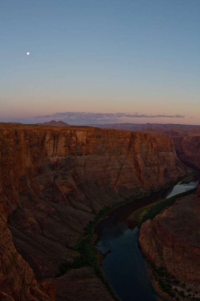 Horseshoe Bend at sunrise with a full moon setting.