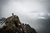 A hiker is caught in a spring squall atop Marcellina Mountain.