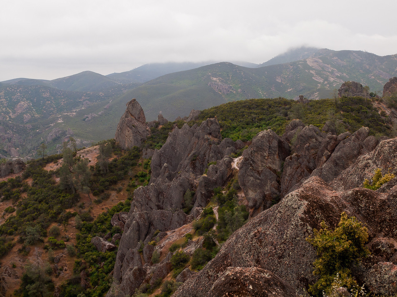 Low clouds obscure far peaks at Pinnacles National Monument.  It rained on us a little during this hike, but not enough to make it miserable.