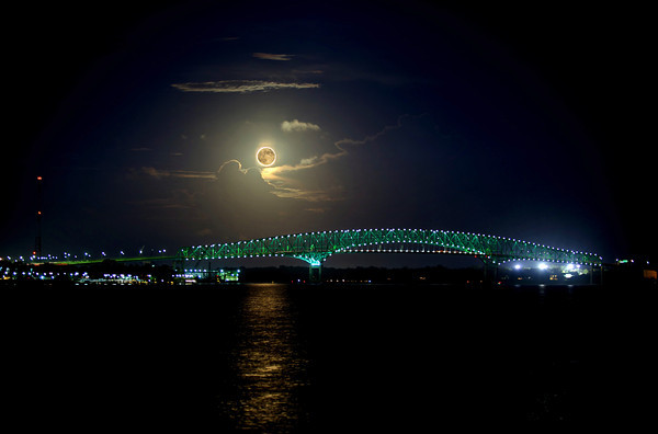 Photo of the super moon over a bridge in downtown Jacksonville, Florida.