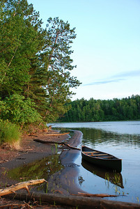 Canoe on the Pokegama: front cover of the 2010 WLSSD Comprehensive Plan and full page image in May 2009 Cabinlife Magazine