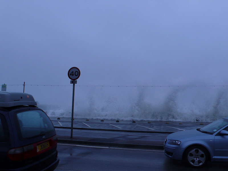 The sea wall takes a battering as tons of water crash rythmically against it every 10-20 seconds.
