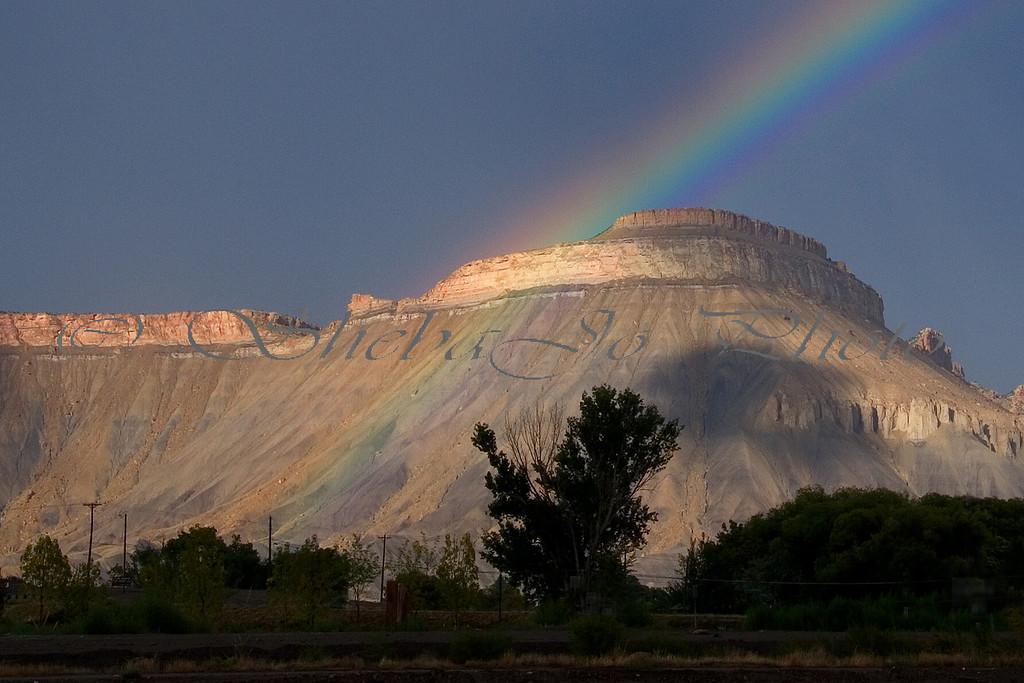 Mt Garfield...rainbow in front.