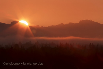 sunrise over Cascades as seen from Woodinville, Washington.