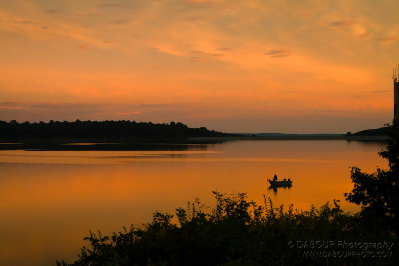 A boater and his last catch of the day at Merrill Creek during sunset